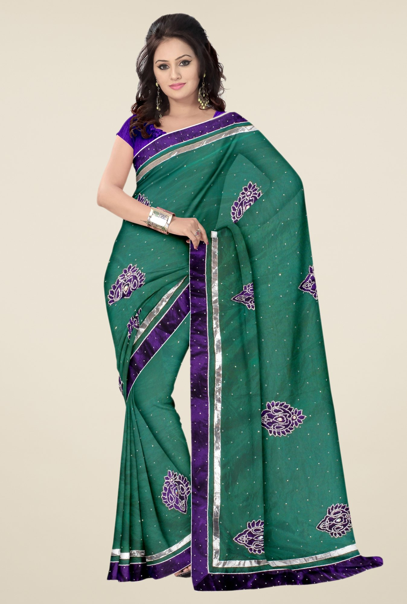 Triveni Sea Green Embroidered Net Saree