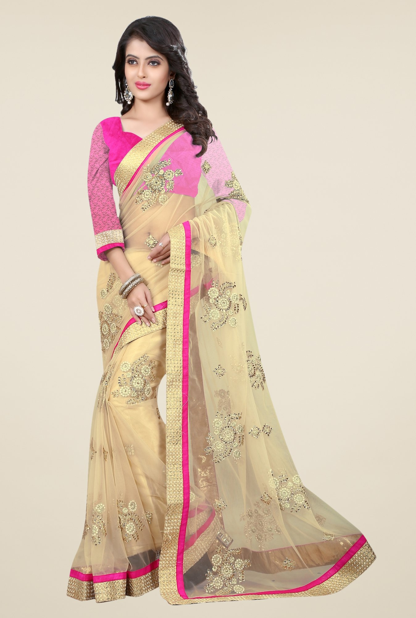 Triveni Beige Embroidered Net Saree