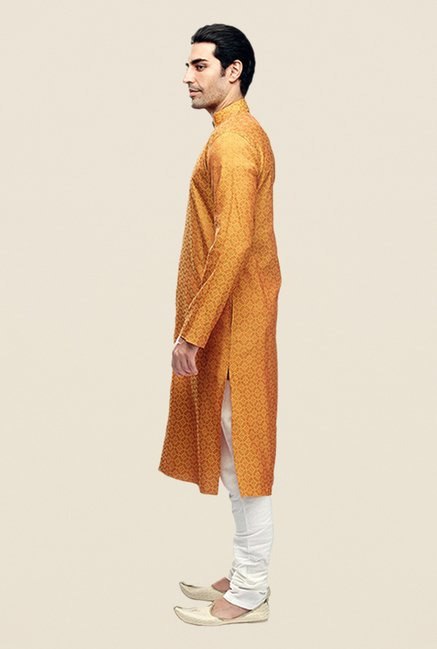 Manyavar Yellowish Orange Self Design Kurta & Churidar