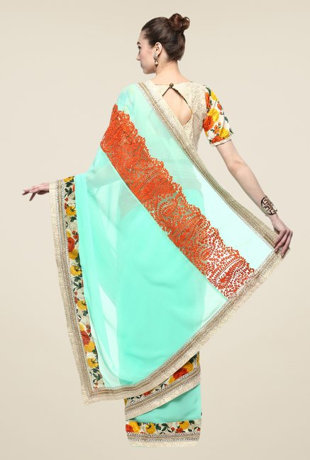 Triveni Turquoise Embroidered Faux Georgette Saree