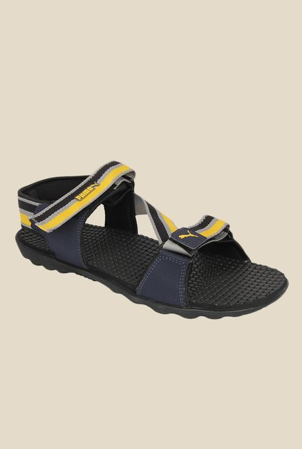 2d5bd6404de3 Buy Puma Silicis DP Navy   Yellow Floater Sandals for Men at Best ...