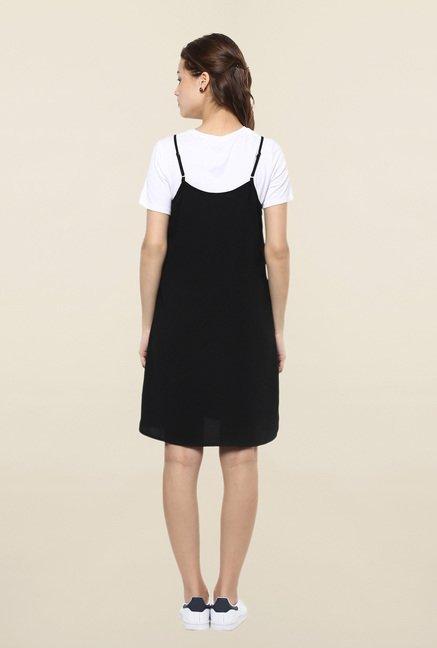 Black slip dress above the knee