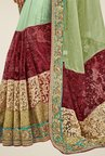 Triveni Green Embroidered Net Lycra Saree