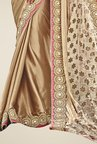 Triveni Beige Embroidered Satin Net Saree