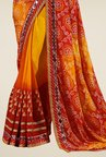 Triveni Impressive Yellow & Red Faux Georgette Saree