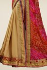 Triveni Sophisticated Beige & Red Chiffon Net Saree