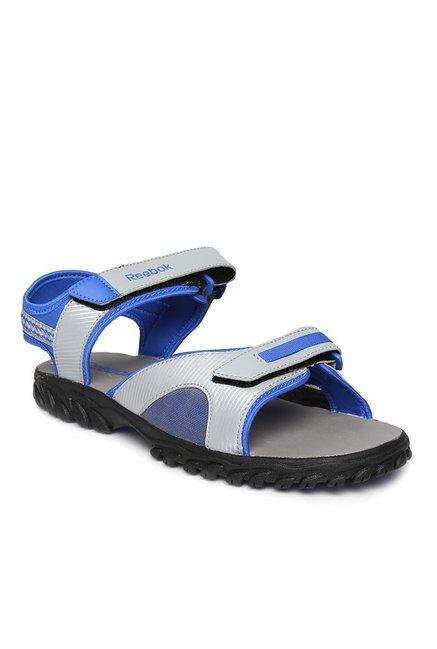 bbceaf5a39ed Buy Reebok Light Grey   Blue Floater Sandals for Men at Best Price ...