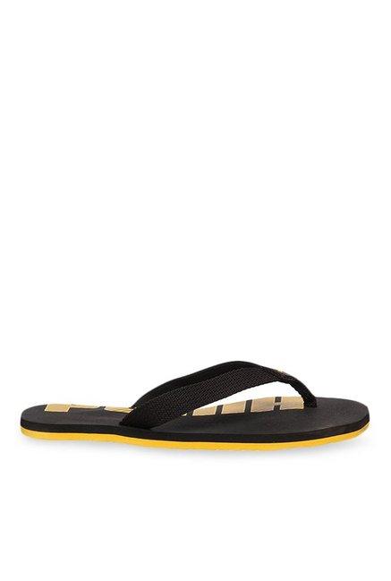 ee67ea306f4e Buy Puma Epic V2 Jr Black   Yellow Flip Flops for Boys at Best Price   Tata  CLiQ