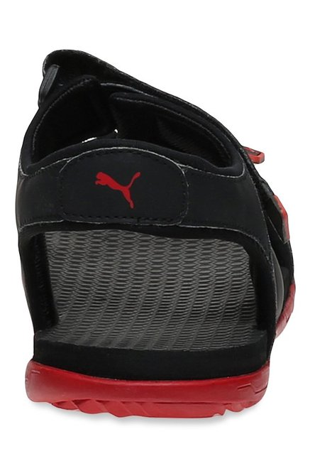 df6d36ef58d9 Buy Puma Elego 2 IDP Black   Barbados Cherry Floater Sandals for Men ...