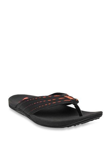 f3fa7f42db37 Buy Nike Keeso Black   Orange Flip Flops for Men at Best Price   Tata CLiQ