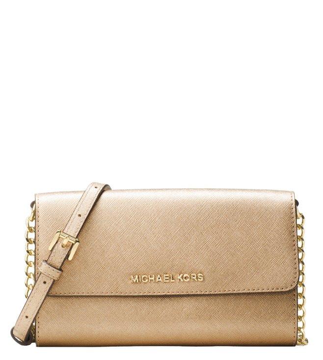 e76a675ef18e Added to Bag. Michael Michael Kors Jet Set Travel Pale Gold Crossbody Bag