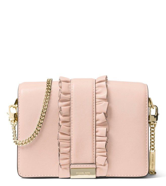 d9f7f6dd0ac8 Michael Kors. MICHAEL Michael Kors Soft Pink Jade Medium Leather Clutch ...