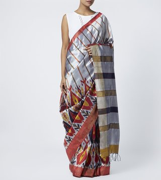 Translate Handwoven Ikat Silver Gladiolas Silk Saree