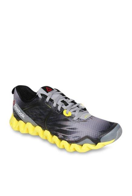 a8a75cf42d9 Buy Reebok Zig Squared Cruz Grey   Yellow Running Shoes for Men ...
