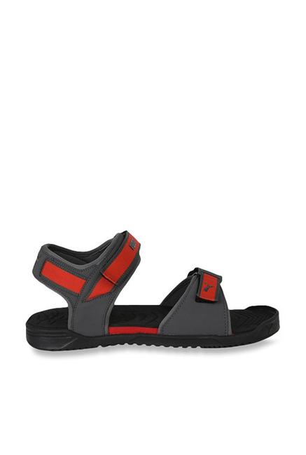 8d4ad1513c69b5 Buy Puma Shine IDP Black   High Risk Red Floater Sandals for Men at ...