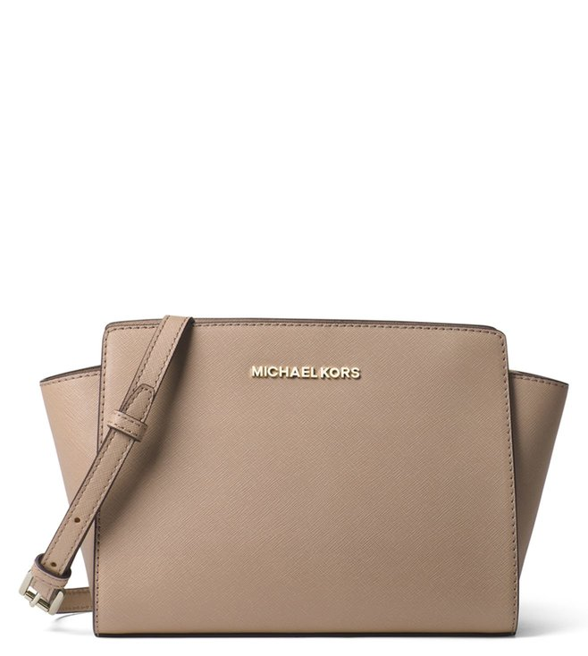4b02bcfc0857 Added to Bag. MICHAEL Michael Kors Truffle Selma Medium Messenger Bag