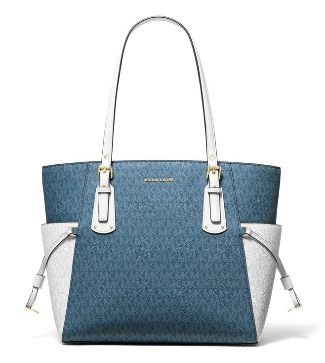 48d0a62fddff Added to Bag. MICHAEL Michael Kors Dark Chambray Multi Voyager Medium Logo  Tote